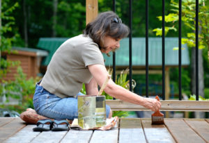 Use a Pressure Washer to Strip and Clean Your Deck Before Staining It